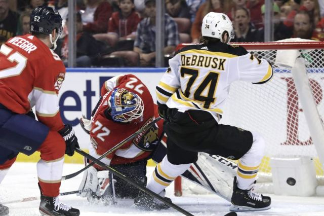 Boston Bruins left wing Jake DeBrusk (74) scores a goal past Florida Panthers goaltender Sergei Bobrovsky (72) during the first period of an NHL hockey game, Saturday, Dec. 14, 2019, in Sunrise, Fla. (AP Photo/Lynne Sladky)