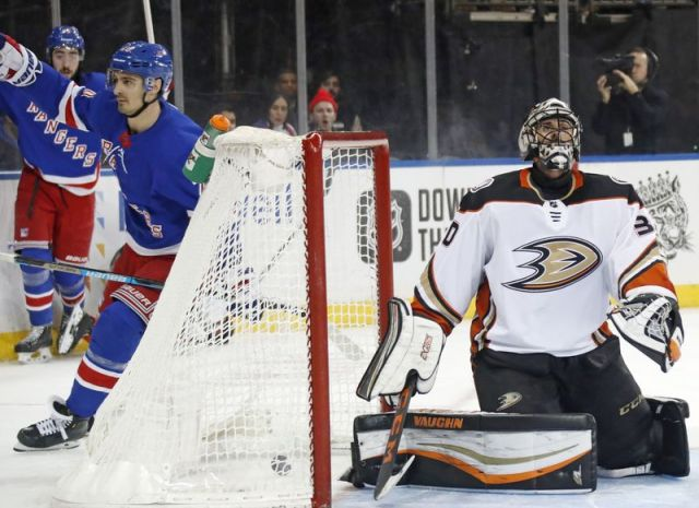 Anaheim Ducks goaltender Ryan Miller (30) reacts as New York Rangers left wing Chris Kreider (20) skates toward his teammates after Kreider scored during the second period of an NHL hockey game, Sunday, Dec. 22, 2019, in New York. (AP Photo/Kathy Willens)