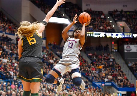 Connecticut's Christyn Williams goes up to shoot as Baylor's Lauren Cox defends in the second half of an NCAA college basketball game, Thursday, Jan. 9, 2020, in Hartford, Conn. (AP Photo/Jessica Hill)