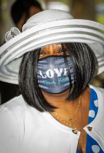 Nancy Vincent of Waterbury sports a nice hat and a love never fails mask during a Mother's Day celebration held Saturday at Lakewood Park in Waterbury. The event was hosted by the Black Women United Committee. Jim Shannon Republican American