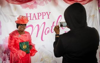Honoree Patricia Morrison, Spiritual Mother gets her photo taken by her granddaughter Tiara Fountain of Bridgeport during a Mother's Day celebration held Saturday at Lakewood Park in Waterbury. The event, hosted by the Black Women United Committee, honored Morrison and three others for their commitment to community and family. Jim Shannon Republican American