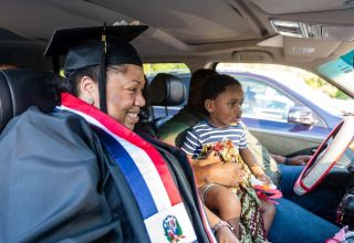 Northwestern Connecticut Community College graduate Johanny Blalock of Waterbury sits in her vehicle with her husband, Oronde Blalock, and Javion Brown, 2, the granddaughter of Yvonne Brown, professor in the NCCC languages department, during graduation Thursday at Five Points Center for the Visual Arts in Torrington. Johanny Blalock graduated with a degree in the interpreter training program ASL/ENG. Jim Shannon Republican-American