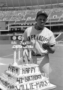 FILE - San Francisco Giants centerfielder Willie Mays eats part of a cake presented to him at home plate on his 41st birthday, before the start of the game with the Philadelphia Phillies at Veterans Stadium in San Francisco, in this May 6, 1972, file photo. Mays turns 90 on Thursday, May 6, 2021. (AP Photo/File)