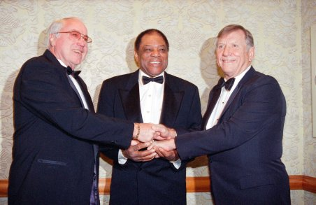 """FILE - This Jan. 22, 1995, file photo shows from left, Duke Snider, Willie Mays and Mickey Mantle joining hands as they pose at the New York chapter dinner of the Baseball Writers Association, in New York. In 1979, Mays was the only player elected to the Hall of Fame by the baseball writers. Snider said at the time, """"Willie more or less really deserves to be in by himself."""" (AP Photo/Eric Miller, File)"""