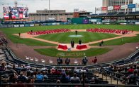 Northwestern Regional High School graduates sit on the ball field as parents watch from the stands during graduation ceremonies Wednesday at Dunkin' Donuts Park in Hartford. Jim Shannon Republican American