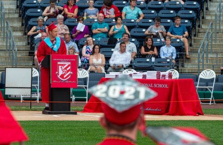 Northwestern Regional High School Class Vice President Zavier Langendoerfer gives the invocation during graduation ceremonies Wednesday at Dunkin' Donuts Park in Hartford. Jim Shannon Republican American