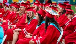 Northwestern Regional High School graduate Sara Chappel is all smiles as she watches fellow graduates make their way to their seats during graduation ceremonies Wednesday at Dunkin' Donuts Park in Hartford. Jim Shannon Republican American