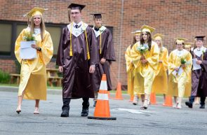 Graduate's march into their ceremony at the school in Thomaston Wednesday. Steven Valenti Republican-American