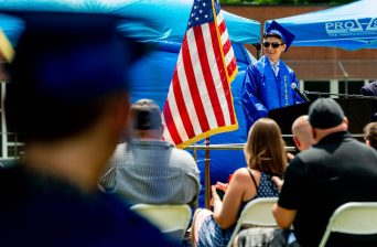 Kevin Loja, Salutatorian for the Class of 2021, gives his remarks during graduation ceremonies Friday at Oliver Wolcott Technical High School in Torrington. Jim Shannon Republican American