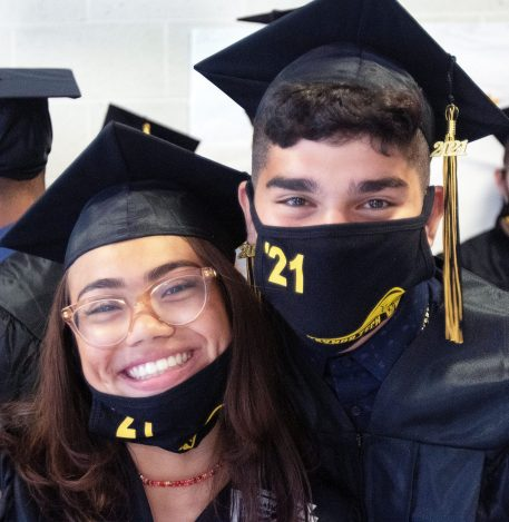From left, Yulissa Navarrete, 18 of Waterbury and Carlos Lara, 17 of Watertown celebrate during their ceremony at Kaynor Tech High School in Waterbury Friday. Steven Valenti Republican-American