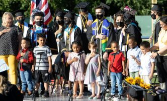 The pre-kindergarten Spartans for the school says the Pledge of Allegiance during the Waterbury Career Academy graduation at Municipal Stadium in Waterbury Wednesday. Steven Valenti Republican-American