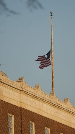 A tattered American flag files atop Southern New England Telephone Co. on Grand Street in Waterbury in 2013. It was replaced after the photo was taken. Flag etiquette calls for frayed or torn U.S. flags to be retired with respect. Several civic groups, from Scouts to veterans, conduct formal flag retirement ceremonies at various times during the year. (Jim Shannon Republican-American)