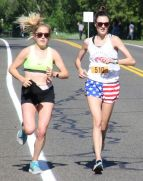 The first female finisher, Oliva Bourquin, right, of Hartford, runs with an unidentified runner near the 4-mile mark. John McKenna Photo