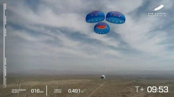 FILE - In this image from video made available by Blue Origin, the New Shepard capsule uses parachutes to land during a test in West Texas on Wednesday, April 14, 2021. Jeff Bezos will ride his own rocket into space next month, joining the first crew to fly Blue Origin. Bezos announced Monday, June 7, 2021, that not only will he launch July 20 from Texas, so will his fireman brother Mark. The highest bidder in a charity auction also will make the 10-minute up-and-down hop. (Blue Origin via AP)