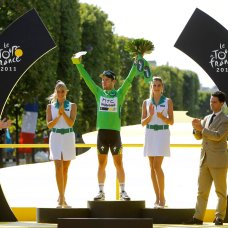 FILE - In this July 24, 2011 file photo, Mark Cavendish of Britain, stands on the podium after winning the best sprinter's title at the Tour de France cycling race in Paris, France, Sunday July 24, 2011. Mark Cavendish has saved the best for the end: matching cycling legend Eddy Merckx's record of 34 Tour de France stage wins at the twilight of his storied career. (AP Photo/Laurent Cipriani, File)
