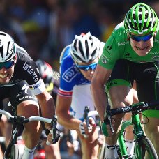 FILE - In this July 10, 2015 file photo, Britain's sprinter Mark Cavendish, left, strains as he sprint towards the finish line ahead of second placed Germany's Andre Greipel, right, and Arnaud Demare of France, center rear, to win the seventh stage of the Tour de France cycling race over 190.5 kilometers (118.4 miles) with start in Livarot and finish in Fougeres, France, Friday, July 10, 2015. Mark Cavendish has saved the best for the end: matching cycling legend Eddy Merckx's record of 34 Tour de France stage wins at the twilight of his storied career. (AP Photo/Peter Dejong, File)