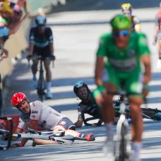 FILE - In this July 4, 2017 file photo, Germany's John Degenkolb, left, and Britain's Mark Cavendish crash during the sprint of the fourth stage of the Tour de France cycling race over 207.5 kilometers (129 miles) with start in Mondorf-les-Bains, Luxembourg, and finish in Vittel, France, Tuesday, July 4, 2017. Mark Cavendish has saved the best for the end: matching cycling legend Eddy Merckx's record of 34 Tour de France stage wins at the twilight of his storied career. (AP Photo/Christophe Ena, File)