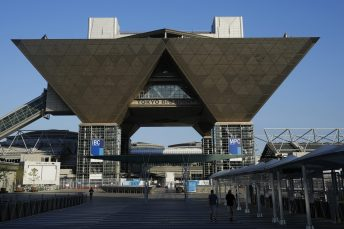 People walk outside the Tokyo Big Sight that houses the International Broadcast Center and Main Press Center in Tokyo, Monday, July 19, 2021. (AP Photo/Natacha Pisarenko)