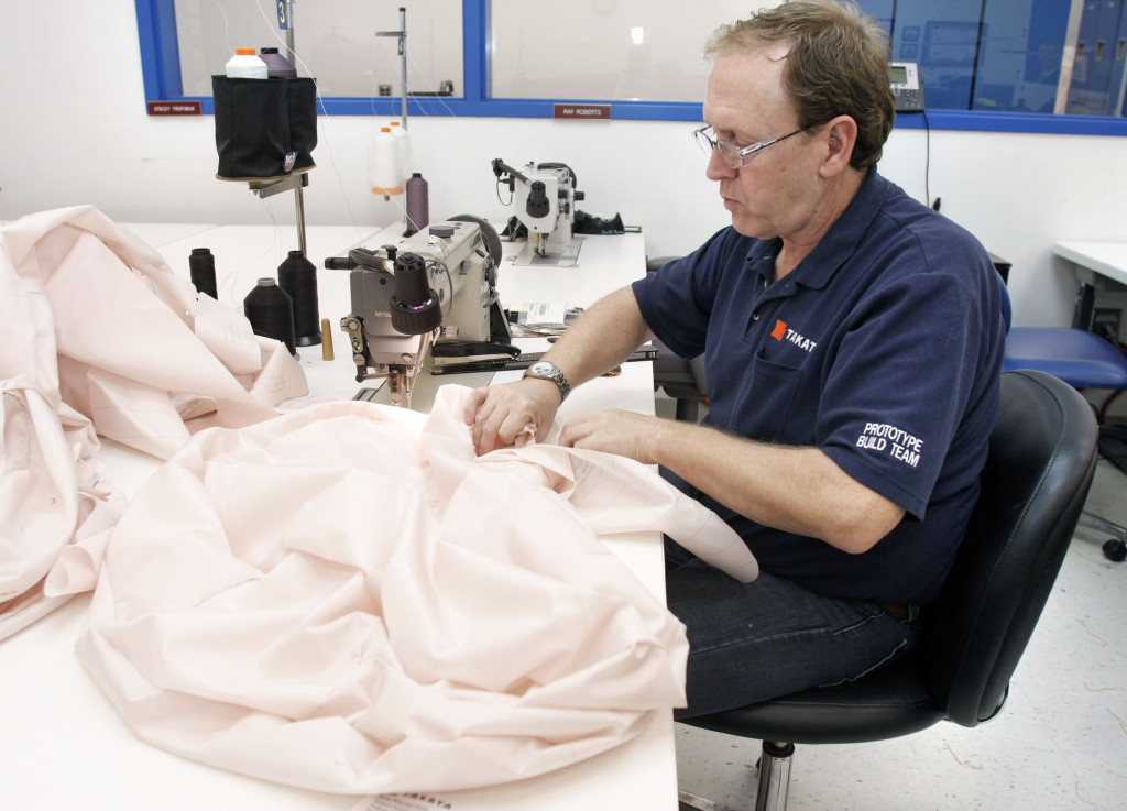 A Takata employee sews an airbag at Takata's crash-testing facility Aug. 19, 2010, in Auburn Hills, Mich. (Bill Pugliano/Getty Images/Thinkstock file.)