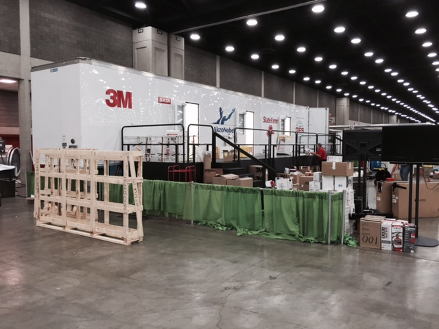 A modified trailer contains separate paint stations for the automotive refinish competition at the SkillsUSA Championships in Louisville, Ky., in June 2015. (Kye Yeung/Society of Collision Repair Specialists) The modified tractor trailer with separate spray stations inside