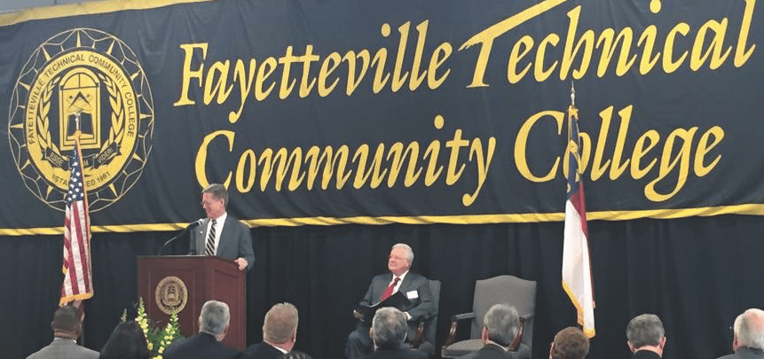 I-CAR CEO John Van Alstyne, left, speaks at the February 2015 grand opening of the Fayetteville Technical Community College collision repair program. FTCC President Larry Keen is at right. (Provided by I-CAR)