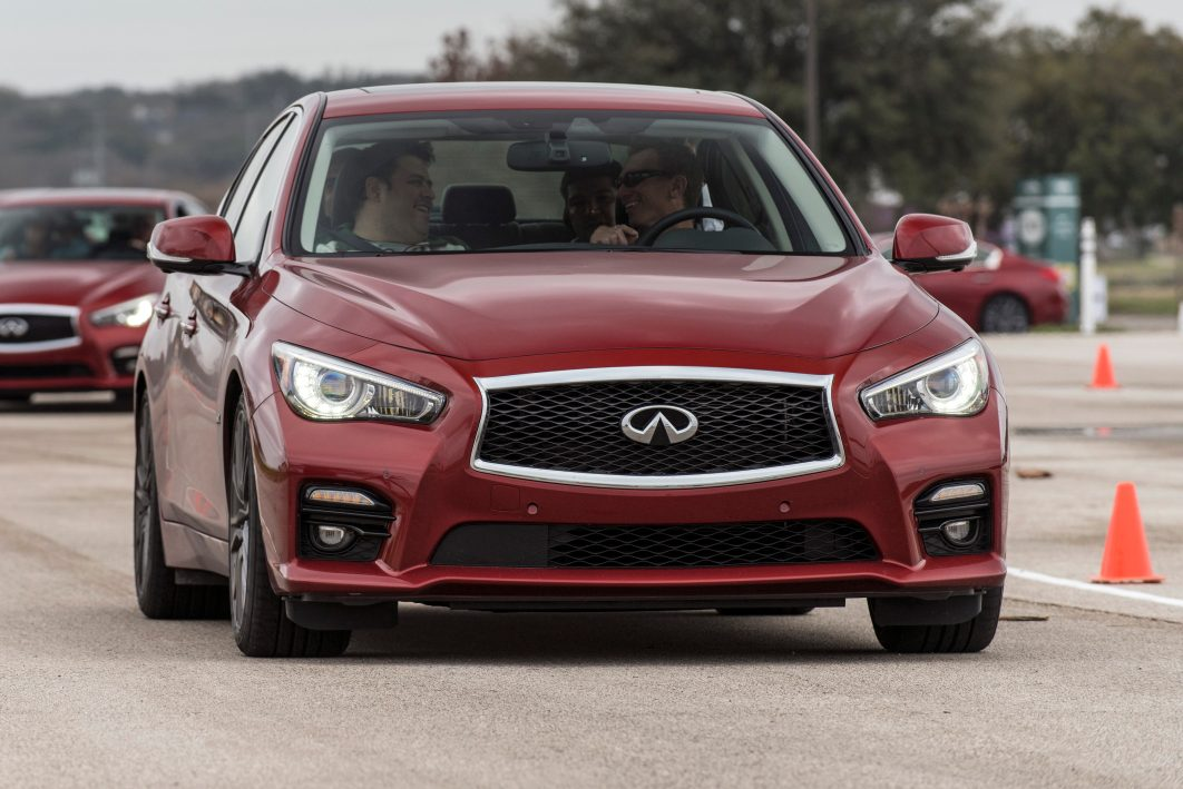 Indications of safety technology on the 2016 Infiniti Q50 can be seen on the rear-view mirror and bumper fascia in this image. (Provided by Infiniti)