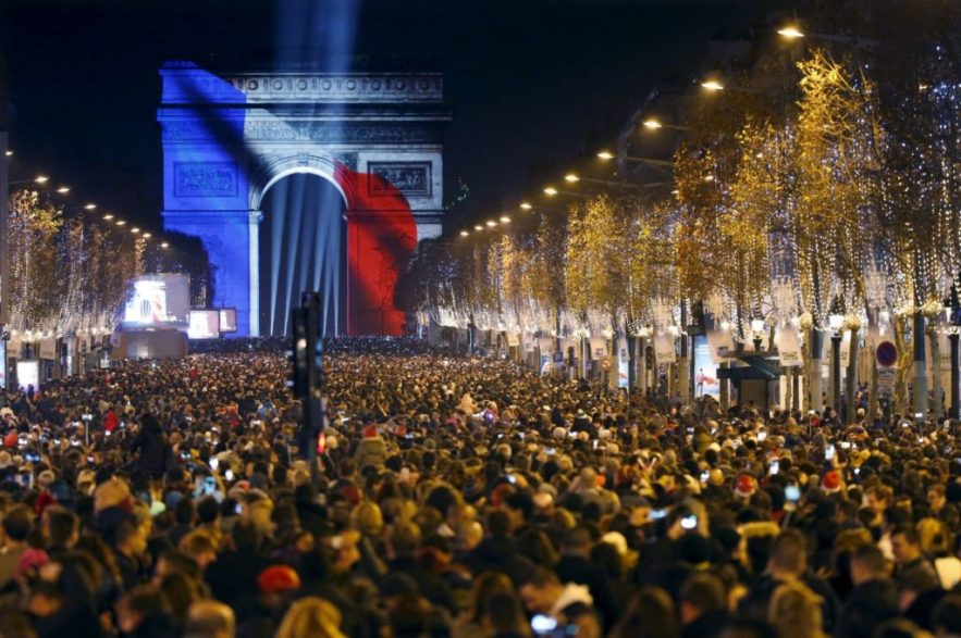 Revellers gather near the Arc de Triomphe, New Year's Eve in Paris