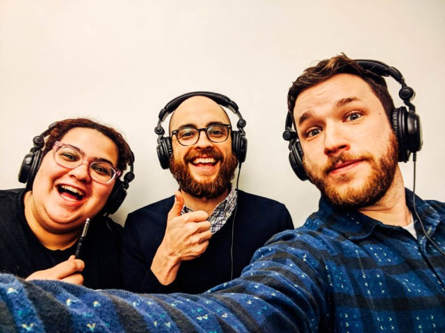 Glo Tavarez, Evan Barden, and Pat Cartelli wearing headphones and posing with a cable