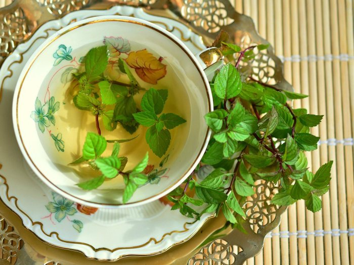 Image of a teacup filled with fresh peppermint tea