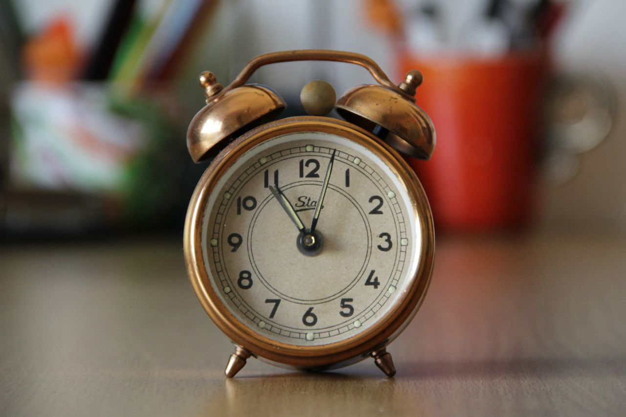 An image of a gold tone alarm clock