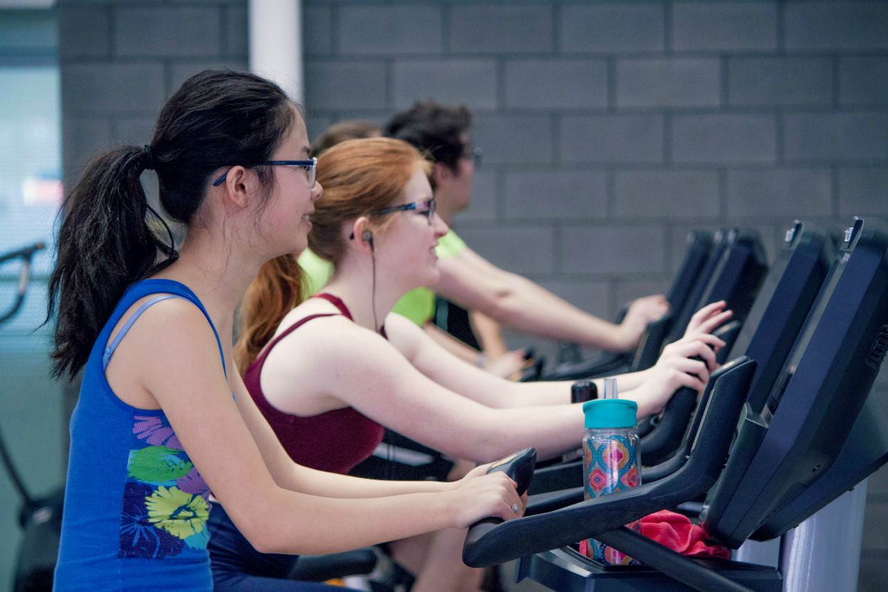 An image of women exercising at the gym
