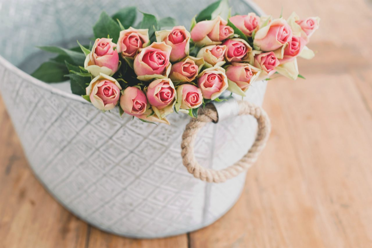An image of roses in a basket