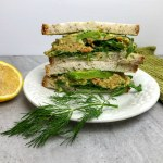An image of a sandwich with artichoke lemon dill sandwich spread.