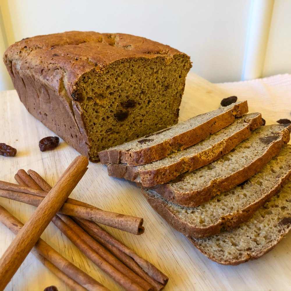 An image of a loaf of sliced gluten-free cinnamon raisin bread.