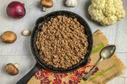 An image of an iron skillet with veggie taco meat in it.
