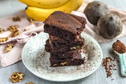 An image of a stack of Double Chocolate Banana Beet Brownies