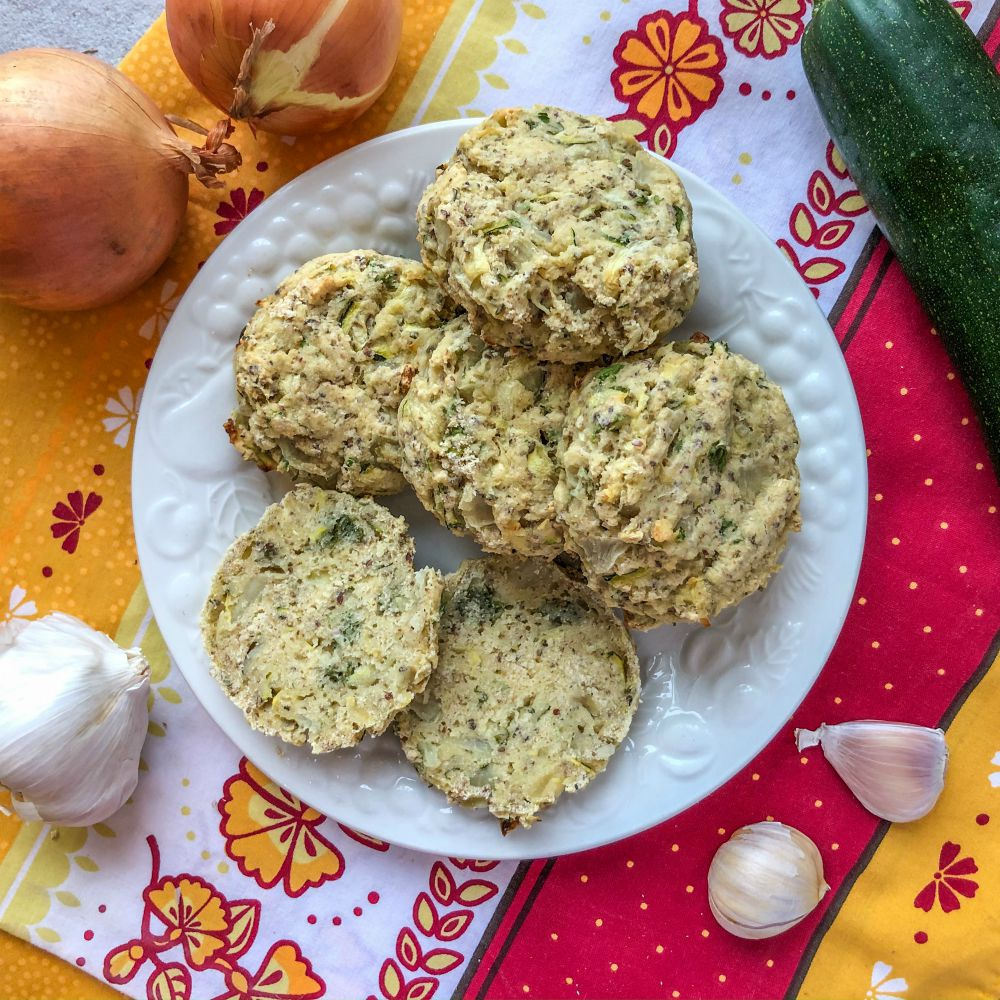 An image of a plate of zucchini and onion scones.