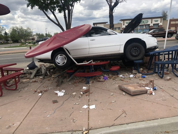 A Toyota Corolla smashed into the picnic area of Dairy Queen at 300 E. Eisenhower Blvd. in Loveland on Saturday. (Dairy Queen / Courtesy photo)