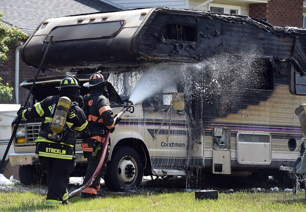 LOVELAND, CO - MAY 29, 2019: Loveland Fire Rescue Authority and Berthoud Fire Protection District firefighters extinguish an RV fire Wednesday, May 29, 2019, at 217 Arabian Court in west Loveland. (Photo by Jenny Sparks/Staff Photographer)
