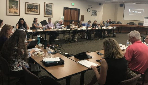 Members of the Larimer County oil and gas task force meet in June to begin advising the county on developing land use rules for oil and gas operations. (Pamela Johnson / Loveland Reporter-Herald)