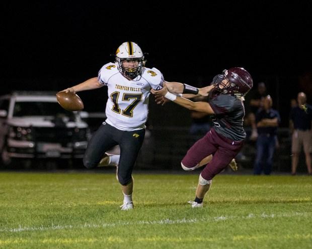 Thompson Valley quarterback James Dyken (17) ...