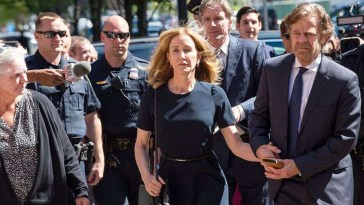 The actress walking with a crowd of police and reporters