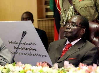 21 February 2017: Zimbabwe's President Robert Mugabe reads a card during his 93rd birthday celebrations in HararePhilimon Bulawayo/Reuters