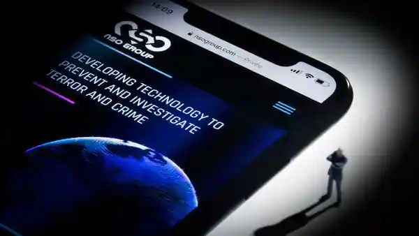 This studio photographic illustration shows a smartphone with the website of Israel