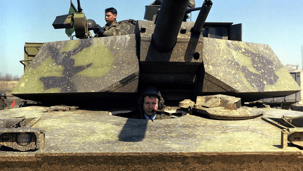 Sen. Mitch McConnell poses inside of a tank in 1985.