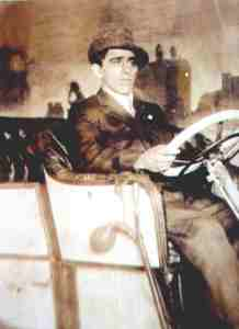 Francisco Pacheco Sr. poses in a car in a studio ca 1915