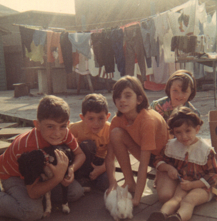 That's me on the left, the youngest, with my siblings and our pets