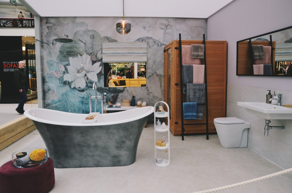 Modern bathroom with burnished metal bath