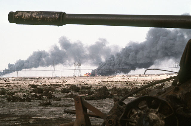 n     A Kuwaiti oil field set afire by retreating Iraqi troops burns in the distance beyond an abandoned Iraqi T-55A tank following Operation Desert Storm. (1991) Photo: JO1 Gawlowicz. Source: DefenseImagery http://www.defenseimagery.mil/imagery.html#guid=cfb81c60059765e70b93e2cc4015383f810a0bfc. Via Wikimedia Commons http://commons.wikimedia.org/wiki/File:Disabled_Iraqi_T-54A,_T-55,_Type_59_or_Type_69_tank_and_burning_Kuwaiti_oil_field.jpg