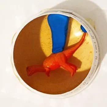 dinosaur model in mold cup